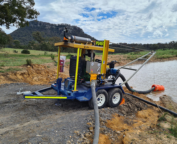 Dewatering pump in action at tailings dam.