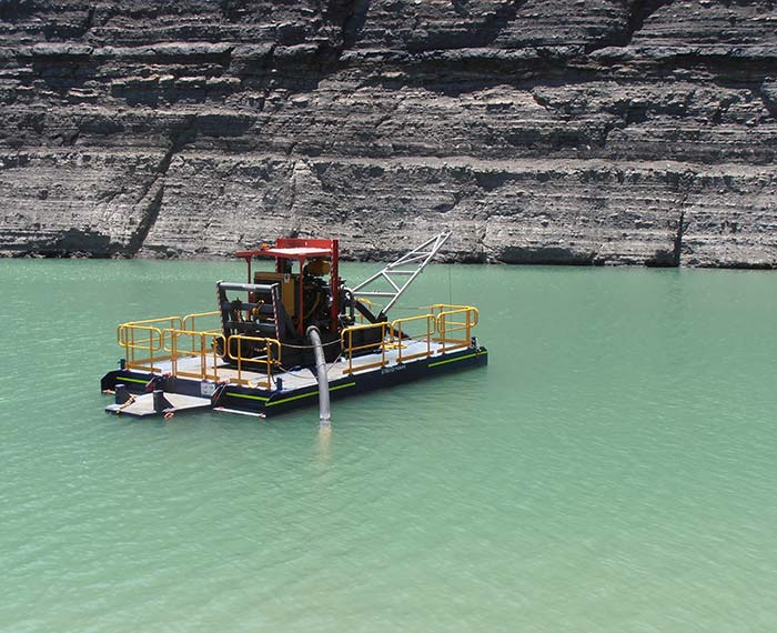 Pontoon pump in operation dewatering a pit