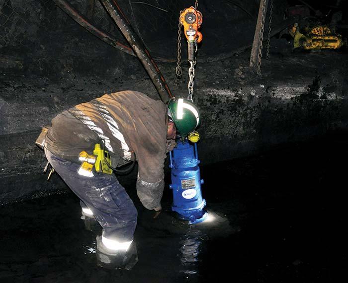 Miner using submersible pump underground